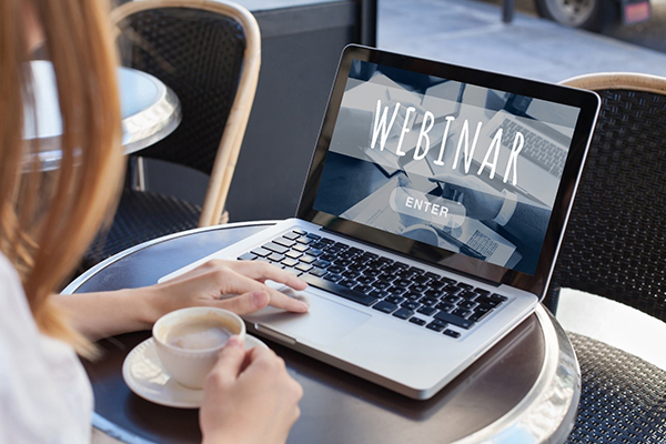 Graphic of a laptop with the word Webinar.